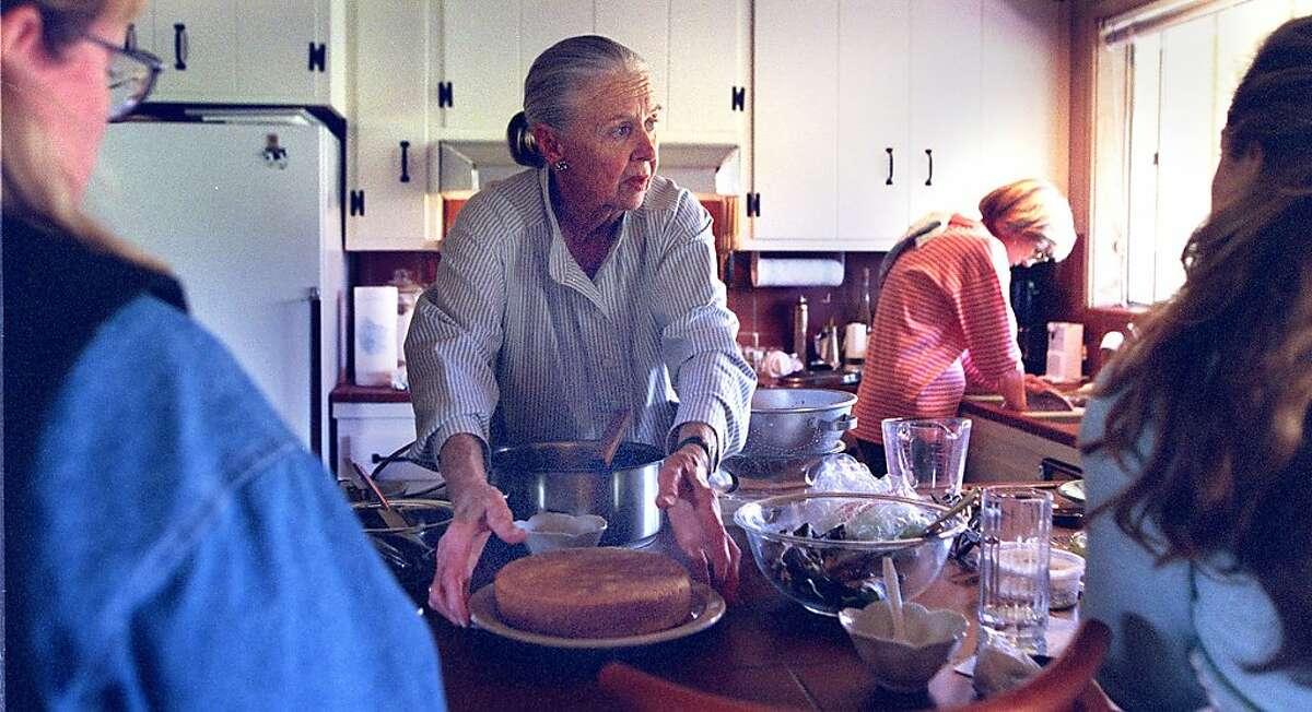 Marion Cunningham teaches students to cook from her quaint kitchen in her Walnut Creek home. They created a herb sauce which can be used on seafood, salad, pasta, potatoes, etc. Betsy Feichtmeir, doing dishes, is assisting Marion in the class.