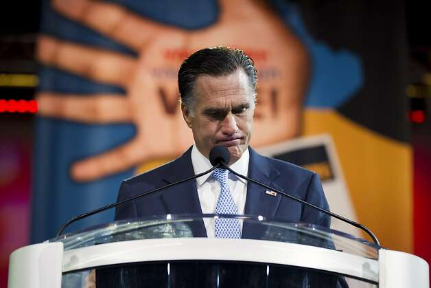 Republican presidential candidate, former Massachusetts Gov. Mitt Romney pauses during a speech before the NAACP annual convention, Wednesday, July 11, 2012, in Houston, Texas.  (AP Photo/Evan Vucci) Photo: Evan Vucci, Associated Press