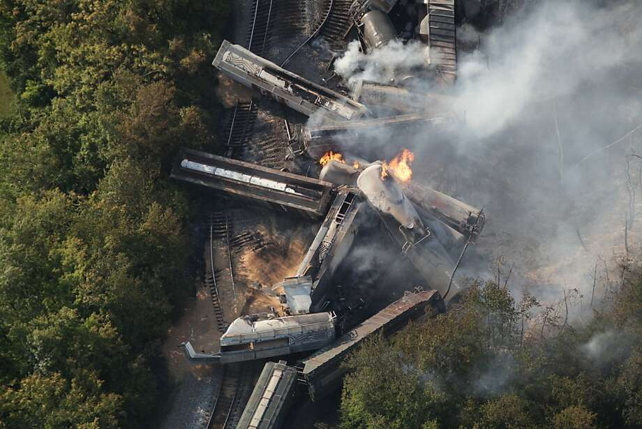 This aerial photograph shows a derailed freight train on Wednesday July 11, 2012 in Columbus, Ohio.  Part of the freight train carrying ethanol derailed and caught fire early Wednesday, shooting flames skyward into the darkness and prompting the evacuation of a mile-wide area as firefighters and hazardous materials crews monitored the blaze.  (AP Photo/The Columbus Dispatch, Doral Chenoweth III)  MANDATORY CREDIT Photo: Doral Chenoweth III, Associated Press