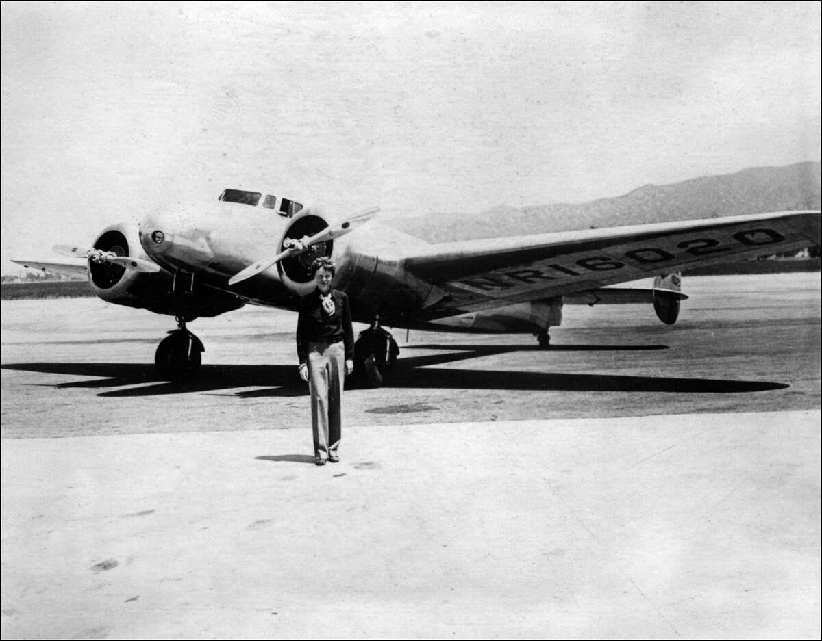Amelia Earhart poses in front of her Lockheed Electra in the 1930s.