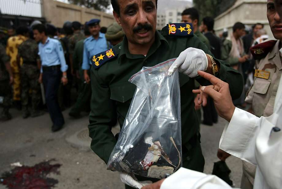A Yemeni police officer holds the collected evidence at the site of an explosion at the entrance of a police academy in Sanaa on July 11, 2012 where a suicide bomber blew himself up killing 20 people and wounding dozens more. The blast is the second deadliest in the capital since President Abdrabuh Mansur Hadi took power in February pledging to destroy Al-Qaeda's presence in the country. AFP PHOTO/ MOHAMMED HUWAISMOHAMMED HUWAIS/AFP/GettyImages Photo: Mohammed Huwais, AFP/Getty Images