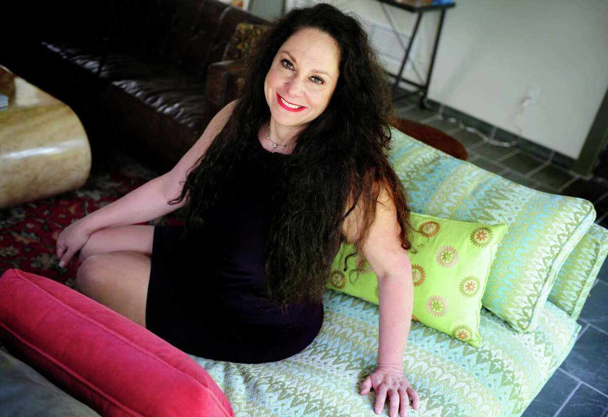 Antoinette Allocca, founder of Essential Data Corporation, poses for a photograph at her home in Easton, Conn.