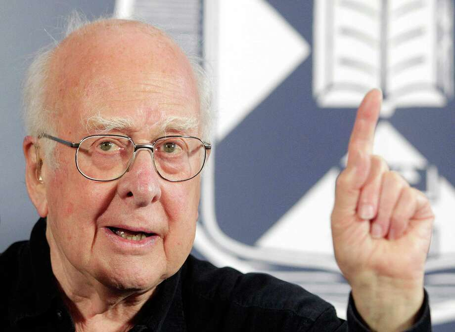 Professor Peter Higgs Photo: GRAHAM STUART / AFP