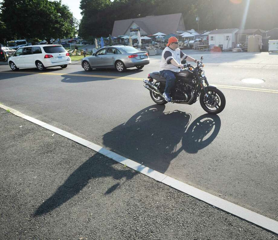 Mike Avesato of Glenville rides his Harley-Davidson XR 1200 on River Road Extension during bike night at Joey B's Famous Chili Hub in Cos Cob, Wednesday, July 11, 2012. Photo: Bob Luckey / Greenwich Time