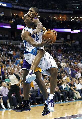 In this March 2012 file photo, New Orleans Hornets' Jarrett Jack goes up for a shot against Laker Metta World Peace.