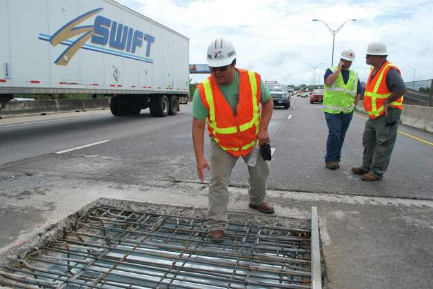 Drivers wait in a long line after a hole in the Neches River Bridge exposed drivers to the water below. Photo: Clay Thorp
