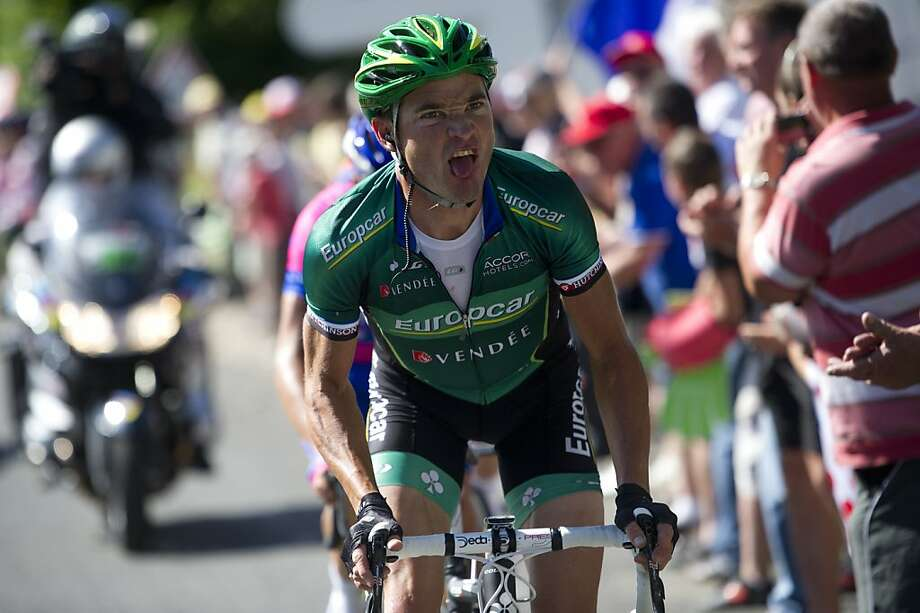 The leading man, France's Thomas Voeckler powers as he climbs in a breakaway in the 194,5 km and tenth stage of the 2012 Tour de France cycling race starting in Macon and finishing in Bellegarde-sur-Valserine, center eastern France, on July 11, 2012.     AFP PHOTO / LIONEL BONAVENTURELIONEL BONAVENTURE/AFP/GettyImages Photo: Lionel Bonaventure, AFP/Getty Images