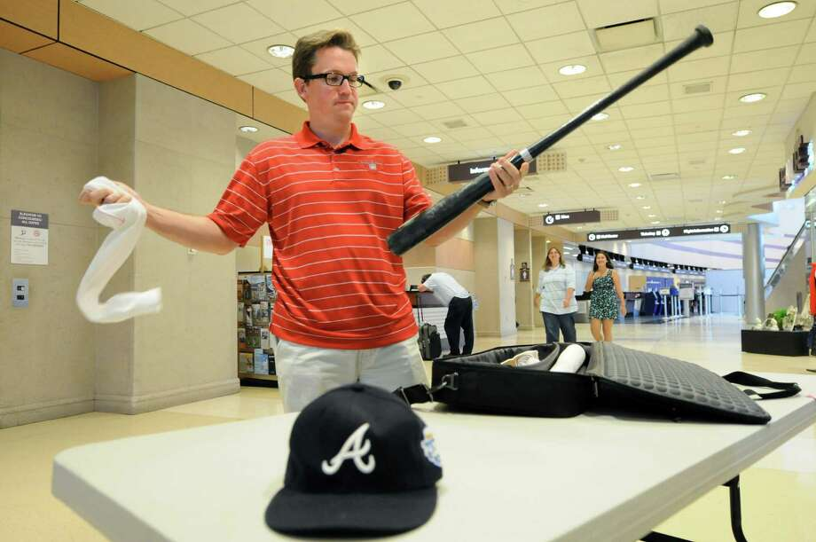 Brad Horn, senior director of communications and education, unwraps a bat bound for the Baseball Hall of Fame on Wednesday, July 11, 2012, at Albany International Airport in Albany, N.Y. The bat was used in the All Stars Game. (Cindy Schultz / Times Union) Photo: Cindy Schultz / 00018422A