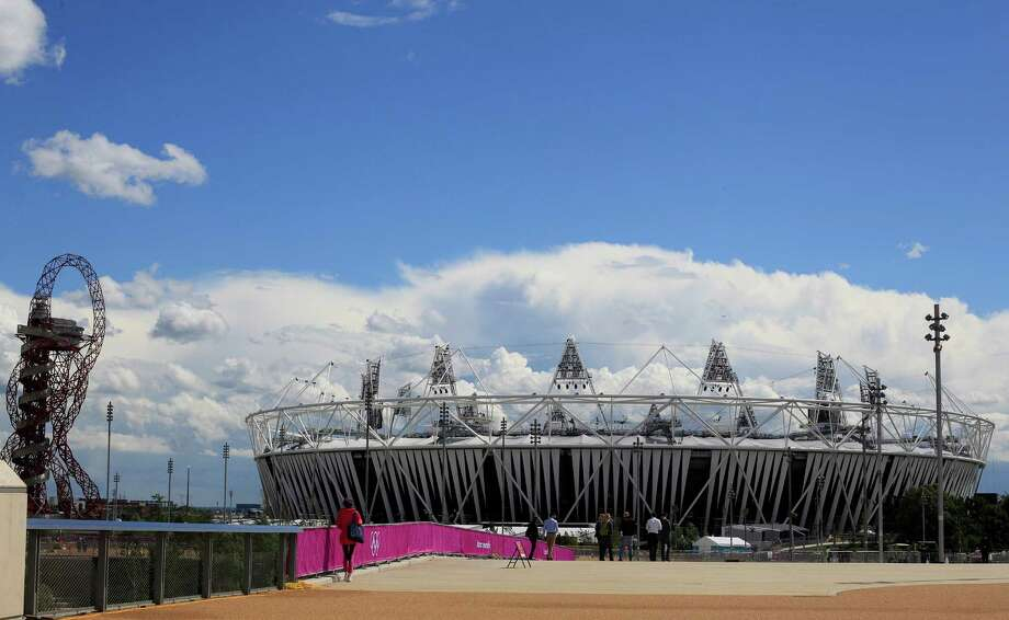 The Olympic Stadium is seen at the London 2012 Olympic Park in east London, Wednesday, July 11, 2012, as work continues to get the park ready for the summer games which begin July 27.(AP Photo/Alastair Grant) Photo: Alastair Grant