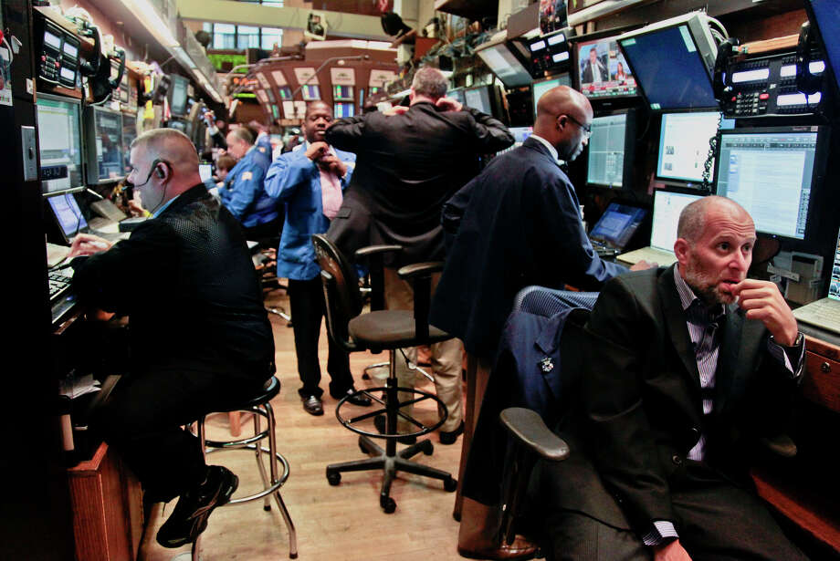 FILE- In this  Tuesday, July 10, 2012, file photo, traders prepare for the start of early trading at the New York Stock Exchange.  (AP Photo/Bebeto Matthews, File) Photo: Bebeto Matthews