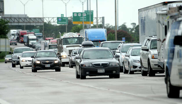 Traffic is backed up near downtown on Interstate 10 eastbound in Beaumont, Wednesday, July 11, 2012. Tammy McKinley/The Enterprise Photo: TAMMY MCKINLEY