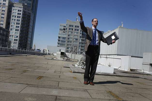 Stephen Wolf with the Bay Area Headquarters Authority,   talks on the roof at 390 Main Street, which is slated to become a new regional headquarters, while conducting a tour after a special joint meeting of the Bay Area Headquarters Authority, Executive Committee of the Board of Directors of the Bay Area Air Quality Management District and the Administrative Committee of the Association of Bay Area Governments  on Wednesday, July 11, 2012 in San Francisco, Calif. Photo: Lea Suzuki, The Chronicle