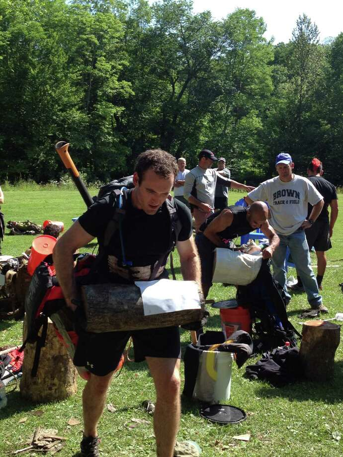 Dennis Sukholutsky participates in the Spartan Death Race, held June 15, 2012 in Pittsfield , Vt. He had to carry the log up the trail, rather than roll it because he was not allowed to get the piece of paper stapled to it dirty. Photo: Courtesy Dennis Sukholutsky