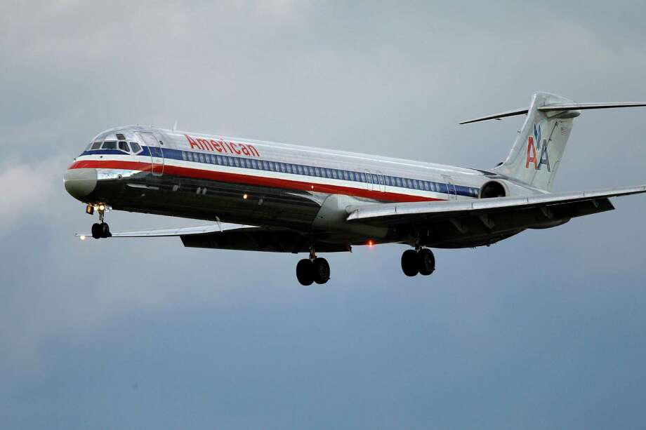 FILE- In this Oct. 29, 2010 file photo, an American Airlines jet airplane approaches Philadelphia International Airport in Philadelphia. American Airlines is weighing various merger options, but most analysts say the nation's No. 3 airline only has one viable choice: partner with US Airways. American could leave bankruptcy protection as an independent. (AP Photo/Matt Rourke, File) Photo: Matt Rourke