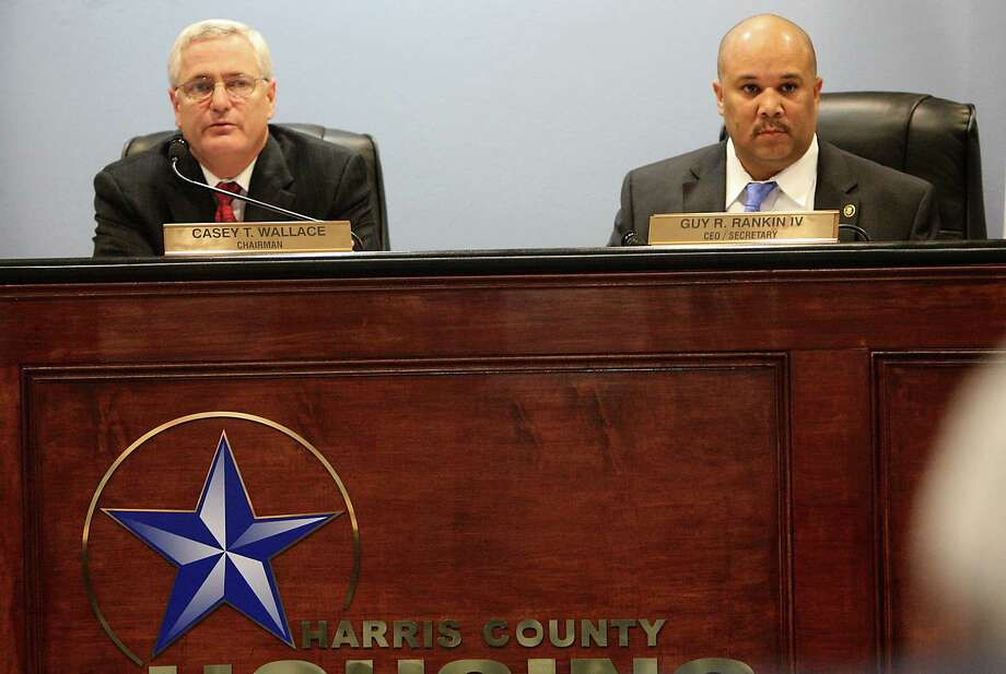 Harris County Housing Authority (HCHA) CEO Guy Rankin, right, sits next to chairman Casey Wallace, left, during the HCHA board meeting on Tuesday, Feb. 7, 2012, in Houston. The five-member board went into executive session after taking care of other business to discuss the contract of Guy Rankin, who might step down, be asked to leave or stay on the board. ( Karen Warren / Houston Chronicle ) Photo: Karen Warren / © 2012  Houston Chronicle