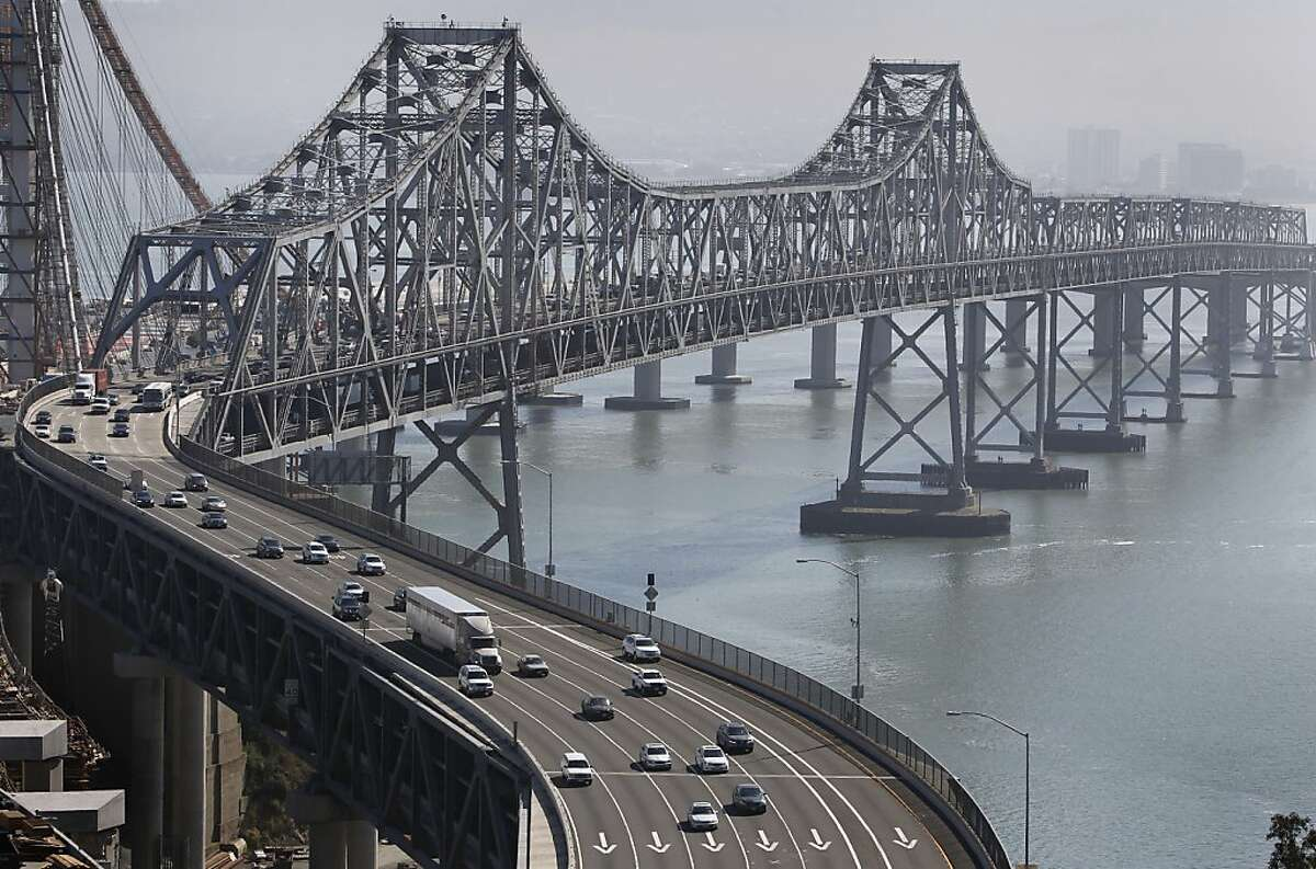 Commuters head westbound on the Bay Bridge towards Yerba Buena Island in San Francisco. Air quality officials declared a
