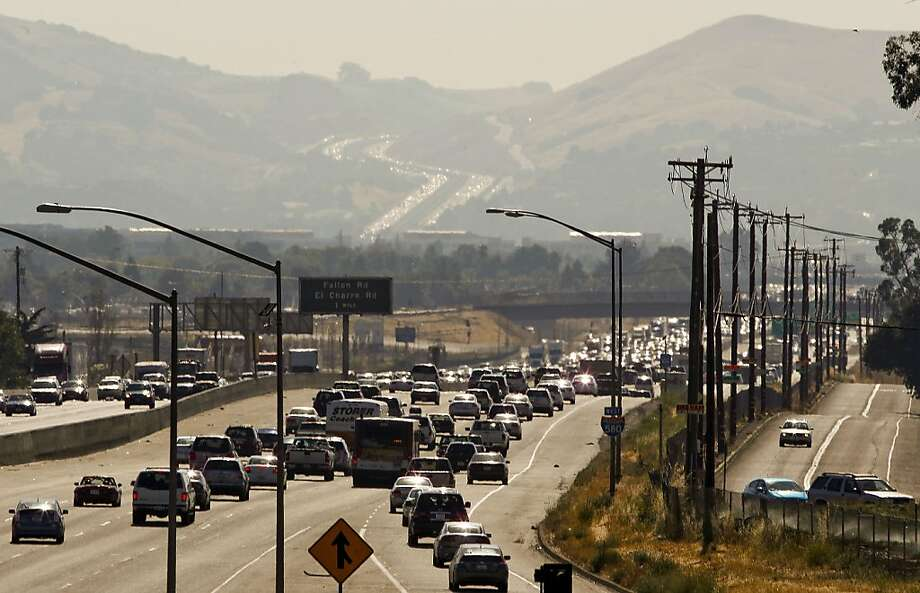 Looking West over the I-580 freeway as it snakes through the Livermore Valle in Livemore, Calif. The Bay Area Air Quality Management District has called for another Spare the Air day for tomorrow Thursday July 12. Photo: Michael Macor, The Chronicle