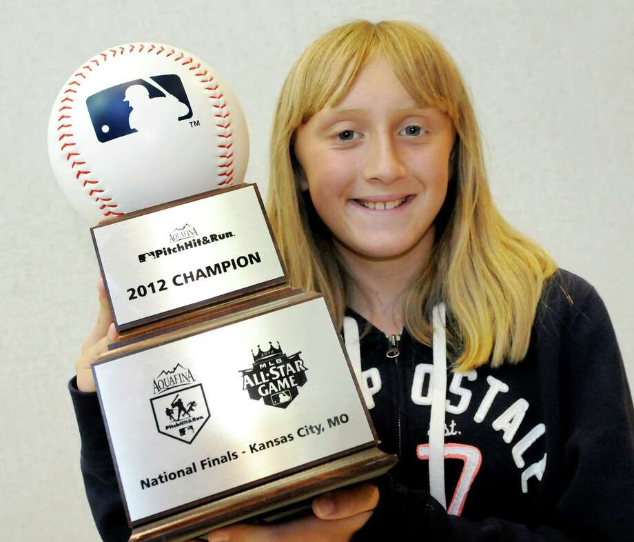 Meghan Dougherty, 10, of East Greenbush, holds her trophy on Wednesday, July 11, 2012, at Albany International Airport in Albany, N.Y. Meghan won in her division in the Pitch, Hit and Run competition during the All Star Game. (Cindy Schultz / Times Union) Photo: Cindy Schultz / 00018422A