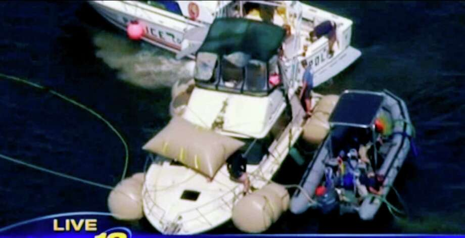 This image made from video and provided by News 12 Long Island shows the Kandi Won from the air on Oyster Bay, off the shore of New York's Long Island, Wednesday, July 11, 2012. The yacht that capsized and sank on July 4, killing three children, has been lifted from the bottom of the bay and will be brought to shore. (AP Photo/News 12 Long Island) MANDATORY CREDIT Photo: News12