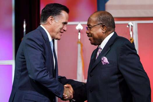 Mitt Romney greets Bishop William Graves before delivering remarks at the NAACP National Convention. Photo: Michael Paulsen / © 2012 Houston Chronicle