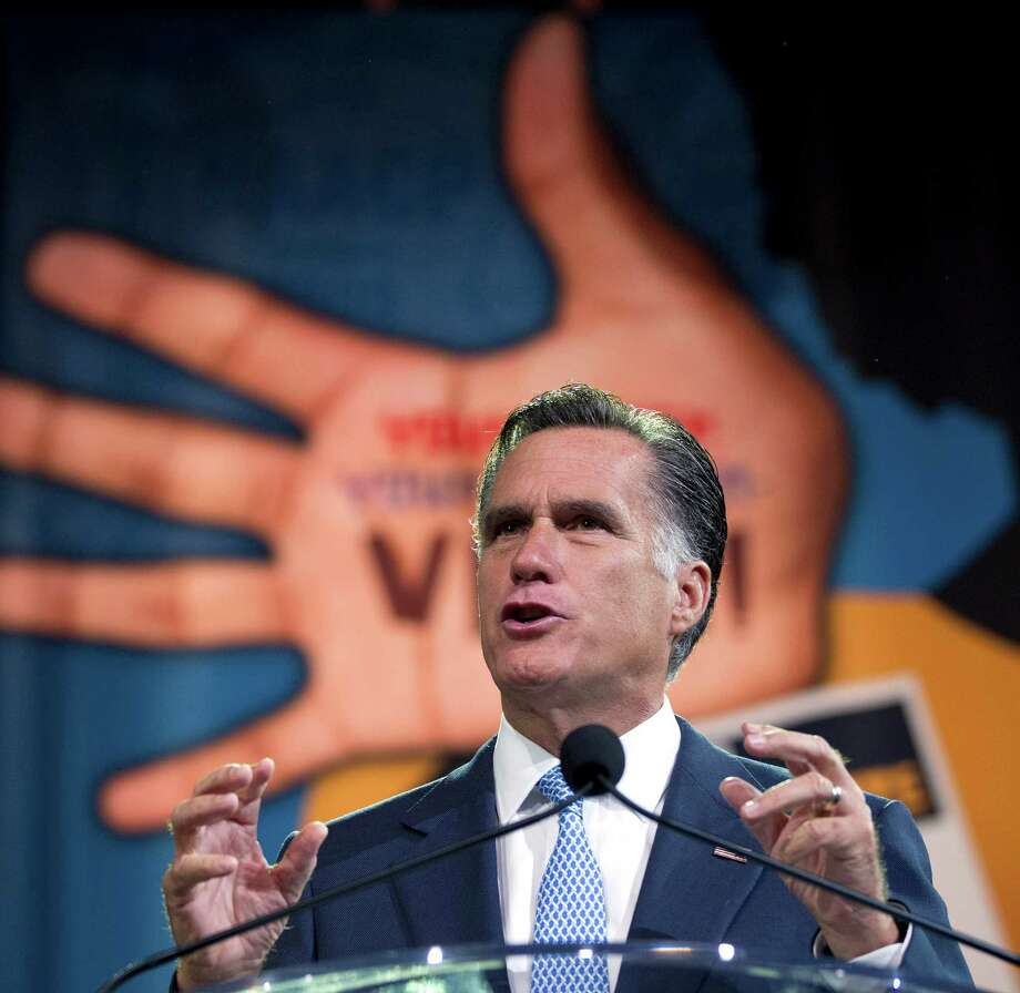 Republican presidential candidate, former Massachusetts Gov. Mitt Romney gestures during a speech to the NAACP annual convention, Wednesday, July 11, 2012, in Houston, Texas.  (AP Photo/Evan Vucci) Photo: Evan Vucci