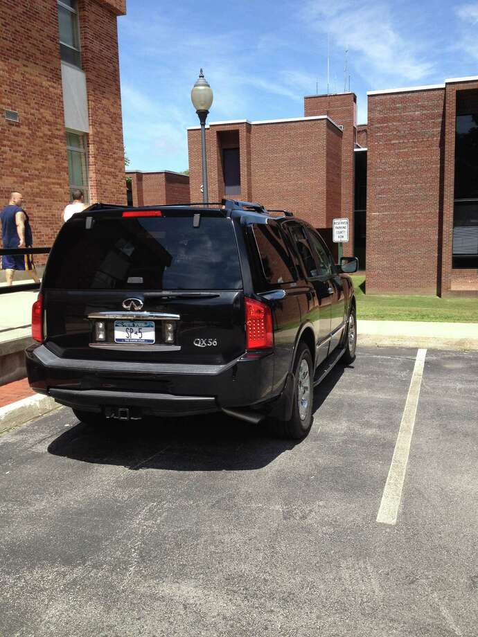 """Saratoga County Administrator Spencer P. Hellwig, whose vehicle is pictured here parked at the county office complex in Ballston Spa, said he doesn't know how long he's had an """"SP"""" plate and likes it because it identifies him as a county resident. (Brendan J. Lyons / Times Union)"""