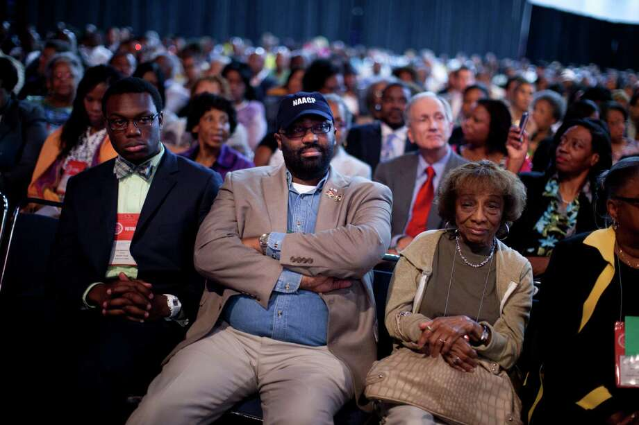 Participants listen to Republican presidential candidate, former Massachusetts Gov. Mitt Romney deliver a speech during the NAACP annual convention on Wednesday, July 11, 2012 in Houston, Texas.  (AP Photo/Evan Vucci) Photo: Evan Vucci, Associated Press / AP