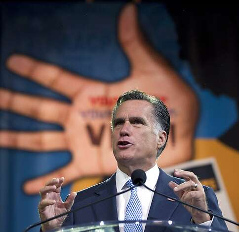 Republican presidential candidate, former Massachusetts Gov. Mitt Romney gestures during a speech to the NAACP annual convention, Wednesday, July 11, 2012, in Houston, Texas.  (AP Photo/Evan Vucci) Photo: Evan Vucci, Associated Press