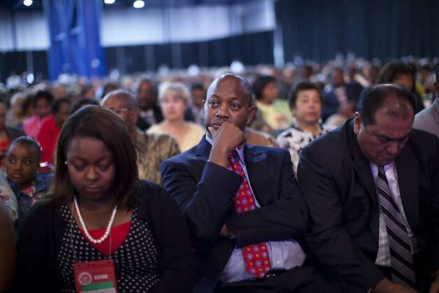 N. Scott Phillips of Baltimore, center, and others, listen as Republican presidential candidate, former Massachusetts Gov. Mitt Romney speaks at the NAACP annual convention, Wednesday, July 11, 2012,  in Houston, Texas.  (AP Photo/Evan Vucci) Photo: Evan Vucci, Associated Press