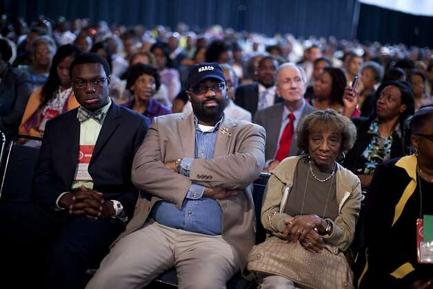 N. Scott Phillips, of Baltimore, Md., listens to Republican presidential candidate, former Massachusetts Gov. Mitt Romney deliver a speech during the NAACP annual convention on Wednesday, July 11, 2012 in Houston, Texas.  (AP Photo/Evan Vucci) Photo: Evan Vucci, Associated Press