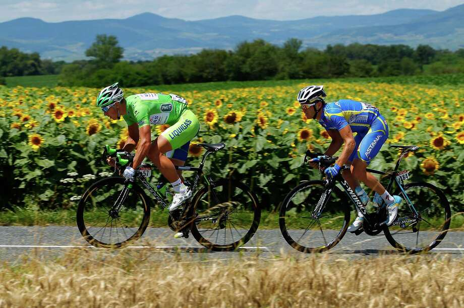Peter Sagan of Slovakia, left, and Andriy Grivko of the Ukraine stage a breakaway early in Wednesday's 10th stage before falling back on the climbs. Photo: Doug Pensinger / 2012 Getty Images