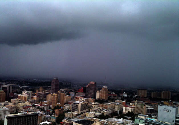 Rain moves into San Antonio on Wednesday, July 11, 2012. The view is from the Tower of the Americas with the use of an iPhone. Photo: John Davenport, San Antonio Express-News / John Davenport/San Antonio Express-News