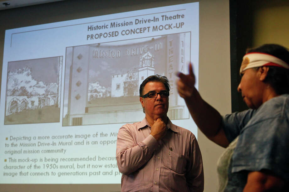 Diane Uriegas (right) voices her concerns to Felix Padrón, Director of the Office of Cultural Affairs for the City of San Antonio, center, and others in attendance at a public meeting for discussion on the Mission Drive-In marquee and mural restoration at the Mission Branch Library in San Antonio on Tuesday, July 10, 2012. Photo: Lisa Krantz, San Antonio Express-News / San Antonio Express-News