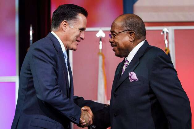Republican presidential candidate Mitt Romney shakes hands with Bishop William Graves before delivering remarks at the 103rd NAACP National Convention at the George R. Brown Convention Center, Wednesday, July 11, 2012, in Houston. Photo: Michael Paulsen, Houston Chronicle / © 2012 Houston Chronicle
