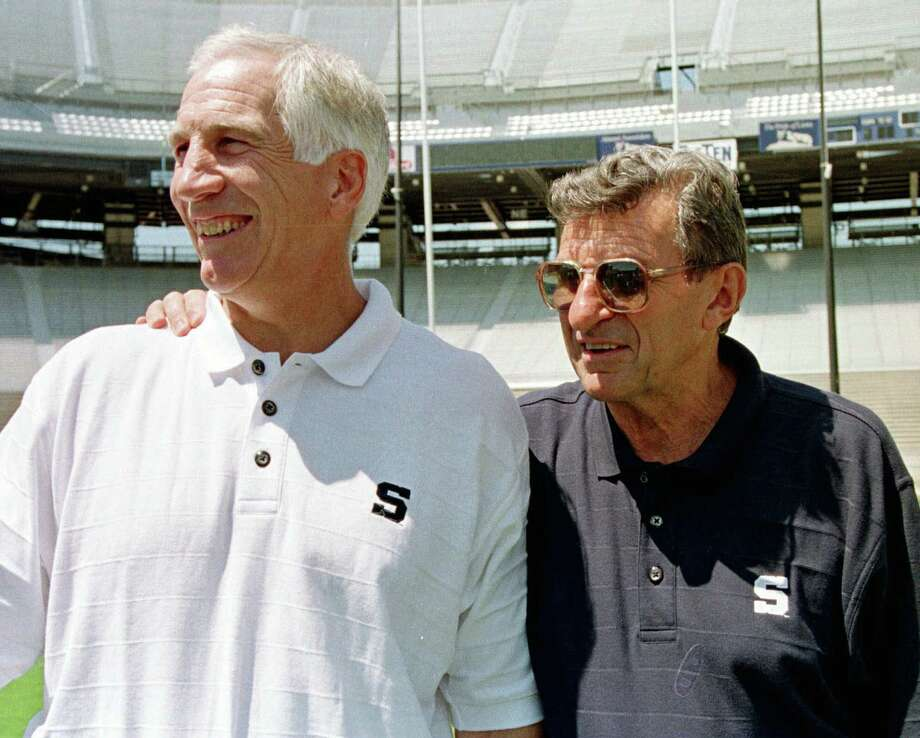 FILE - In this Aug. 6, 1999, file photo, Penn State football coach Joe Paterno, right, poses with his defensive coordinator. Jerry Sandusky, during the college football team's media day in State College, Pa. Former FBI director Louis Freeh, who led a Penn State-funded investigation into the university's handling of molestation allegations against former assistant football coach Jerry Sandusky, is scheduled to release his highly anticipated report Thursday, July 12, 2012. (AP Photo/Paul Vathis, File) Photo: Paul Vathis