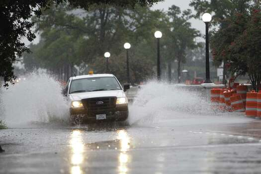 Rain makes Houston's morning work commute messy Thursday, July 12, 2012, in Houston. Photo: Michael Paulsen, Michael Paulsen / Chronicle / Houston Chronicle