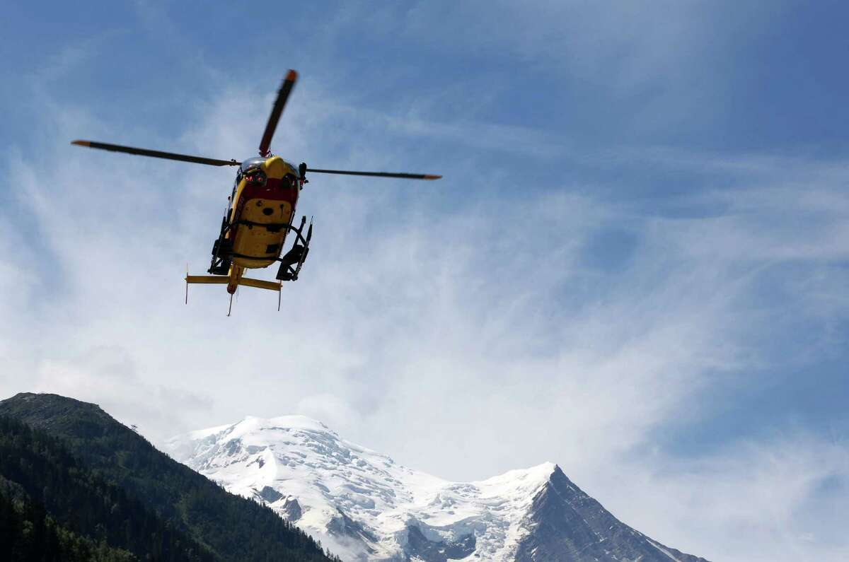 A rescue worker helicopter returning from the avalanche site, lands in Chamonix, French Alps, Thursday,. An avalanche in the French Alps swept nine European climbers to their deaths on a slope leading to Mont Blanc,  A group of 28 climbers from Switzerland, Germany, Spain, France, Denmark and Serbia are believed to be in the expedition caught in the avalanche that was about 4,000 meters (13,1000 feet) high on the north face of Mont Maudit, part of the Mont Blanc range. (AP Photo)
