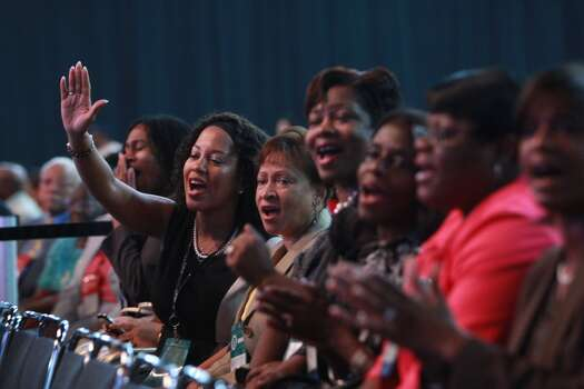 Stephanie Couser of Dallas, at left with arm raised, attends the NAACP convention on Thursday, July 12, 2012. Photo: Johnny Hanson, Houston Chronicle