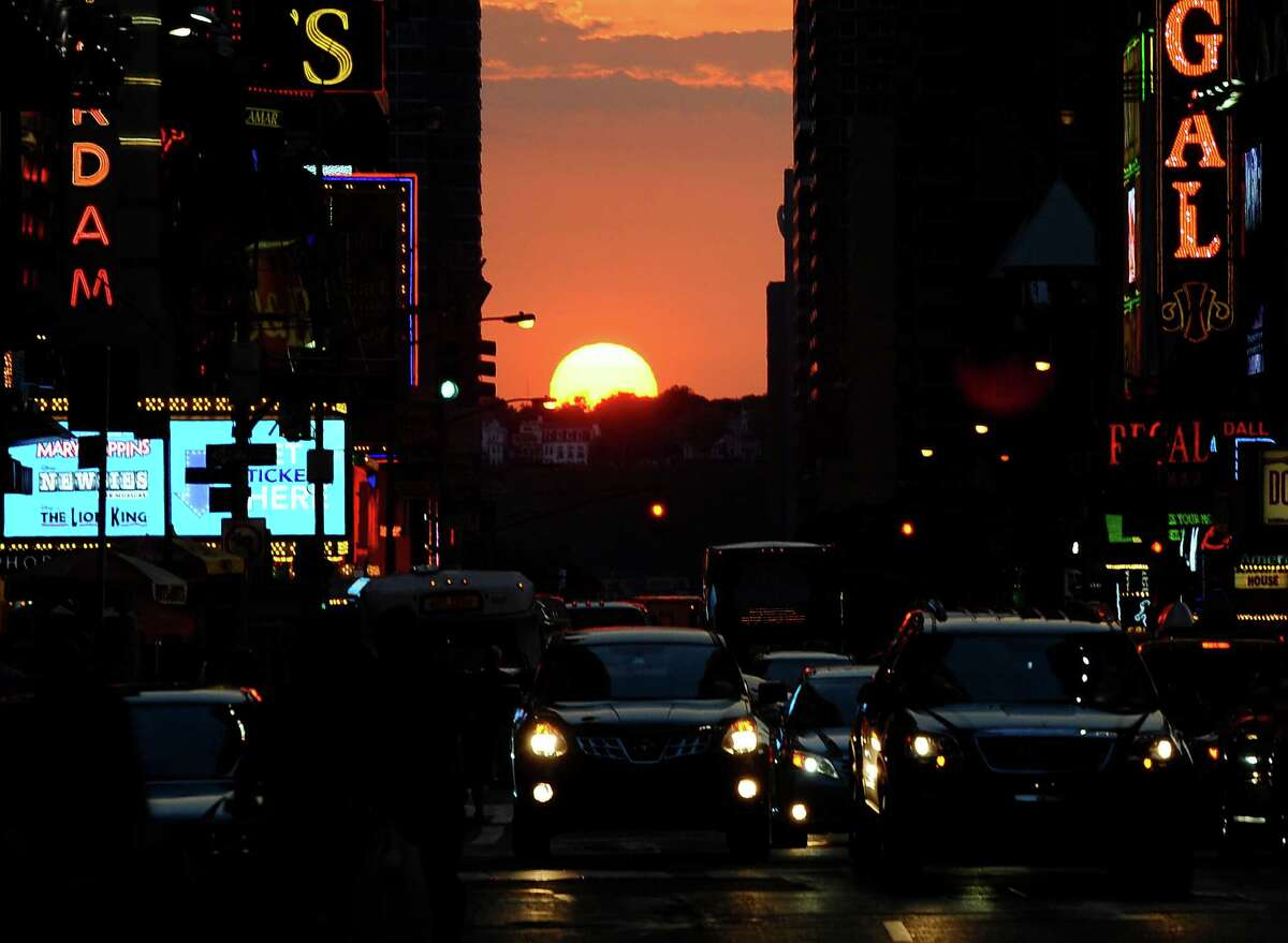 The sun sets as seen from 42nd street in New York City on July 11, 2012, as Manhattanhenge, sometimes also referred to as Manhattan Solstice, the biannual natural event, when it is perfectly aligned with Manhattan?s numbered streets. AFP PHOTO / TIMOTHY A. CLARYTIMOTHY A. CLARY/AFP/GettyImages