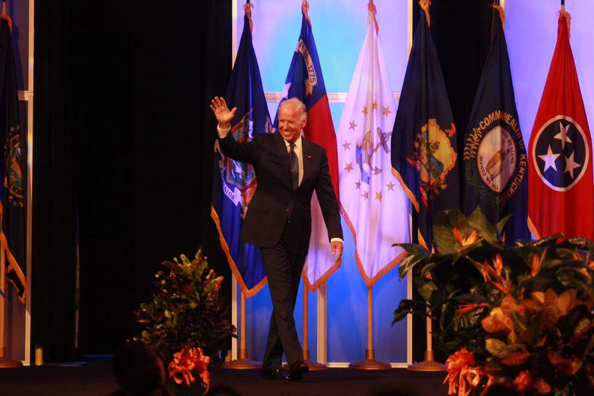 Vice President Joe Biden waves to the crowd as he prepares to address the NAACP convention in Houston Thursday morning.