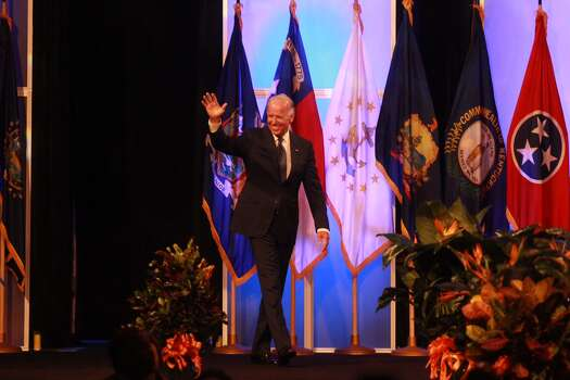 Vice President Joe Biden waves to the crowd as he prepares to address the NAACP convention in Houston Thursday morning. Photo: Johnny Hanson, Houston Chronicle