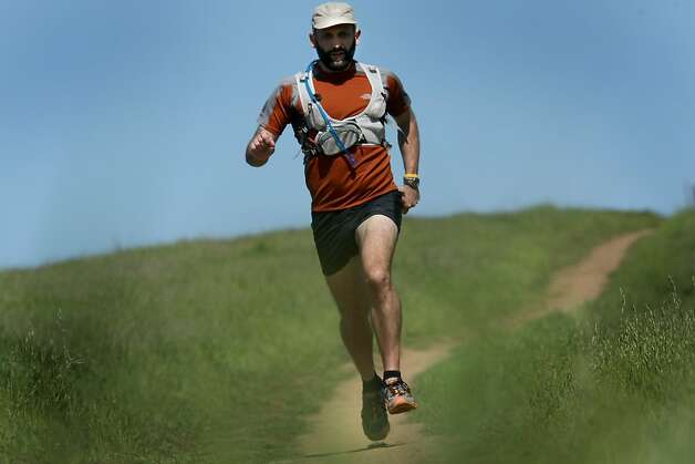 Long distance runner Tony Dunnigan runs at Arastradero Preserve near Palo Alto. Dunnigan, of Palo Alto started running to stay in shape and now runs extreme races up to 200 miles. Photo: Brant Ward, The Chronicle