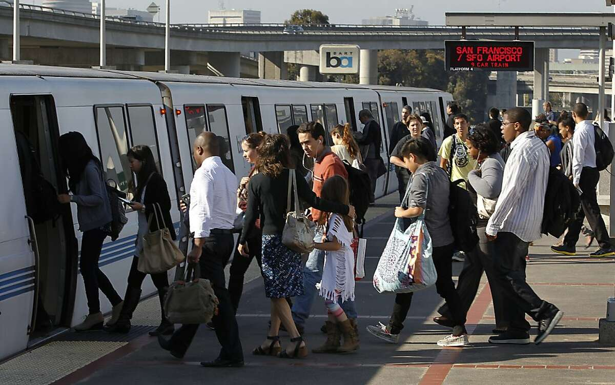 In this file photo, commuters board a San Francisco-bound train at the MacArthur BART station in Oakland. BART is recovering from major system-wide delays Thursday morning after a maintenance vehicle broke down early this morning between the MacArthur and 19th Streetstations.