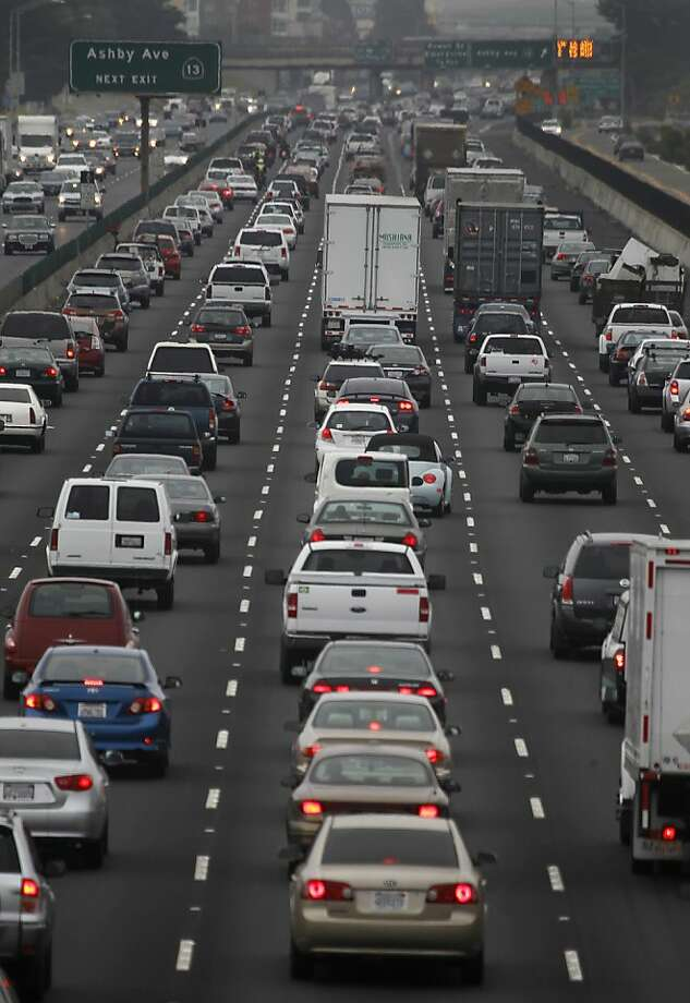 """Commuters drive westbound on Interstate 80 towards the MacArthur Maze and the Bay Bridge in Berkeley, Calif. on Wednesday, July 11, 2012. Sunday Sept. 19, 2015, will be a """"Spare the Air"""" day throughout the Bay Area, thanks to hot temperatures and the potential for smoke to drift south from the Valley Fire, air-quality officials said. Photo: Paul Chinn, The Chronicle"""