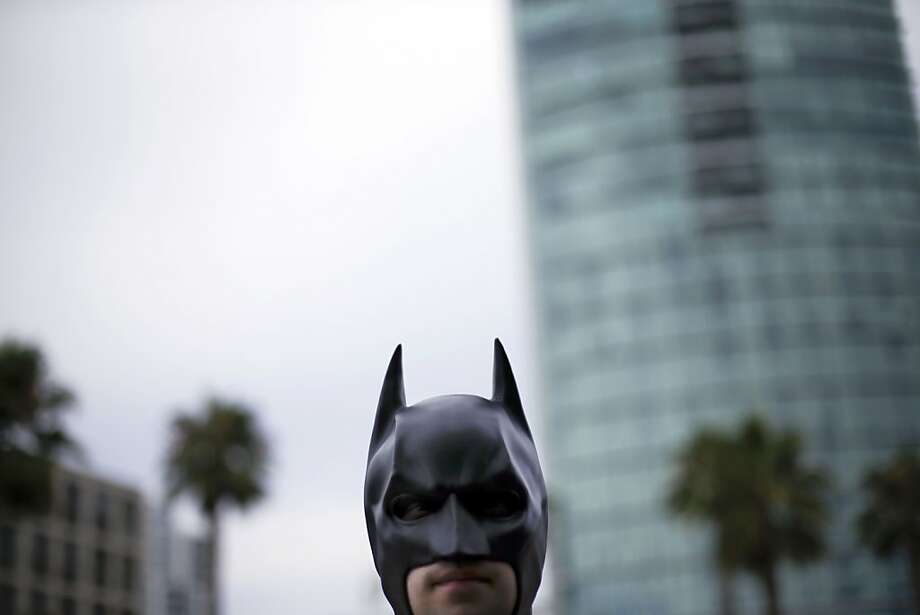 This is a job for someone pretending to be Batman: To protect his identity as a millionaire playboy, Jordan Kruegar arrives in costume at Comic-Con in San Diego. Photo: Gregory Bull, Associated Press