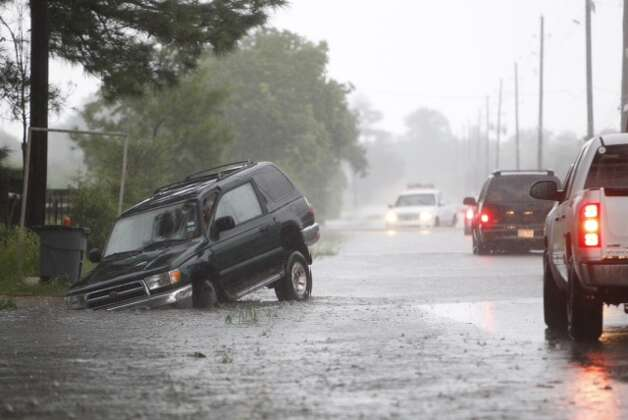 Roads swollen with rains makes for dangerous travel in Houston Thursday, July 12, 2012. Photo: Michael Paulsen, Michael Paulsen / Chronicle / Houston Chronicle