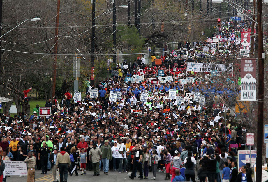 "METRO -- Tens of thousands participate in the City of San Antonio Martin Luther King, Jr., 25th anniversary Commemorative March, Monday, Jan. 16, 2012. This year's theme was ""Journey Beyond the March...Live Beyond the Dream"". JERRY LARA/glara@express-news.net Photo: JERRY LARA, San Antonio Express-News / SAN ANTONIO EXPRESS-NEWS"