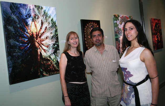 OTS/HEIDBRINK - Curator Heidi Allen, from left, guest David Cuellar and art agent Robyn Greer gather at the 1st Friday exhibit at A. Andrew Gonzalez Gallery on 7/6/2012. names checked photo by leland a. outz Photo: LELAND A. OUTZ, SPECIAL TO THE EXPRESS-NEWS / SAN ANTONIO EXPRESS-NEWS