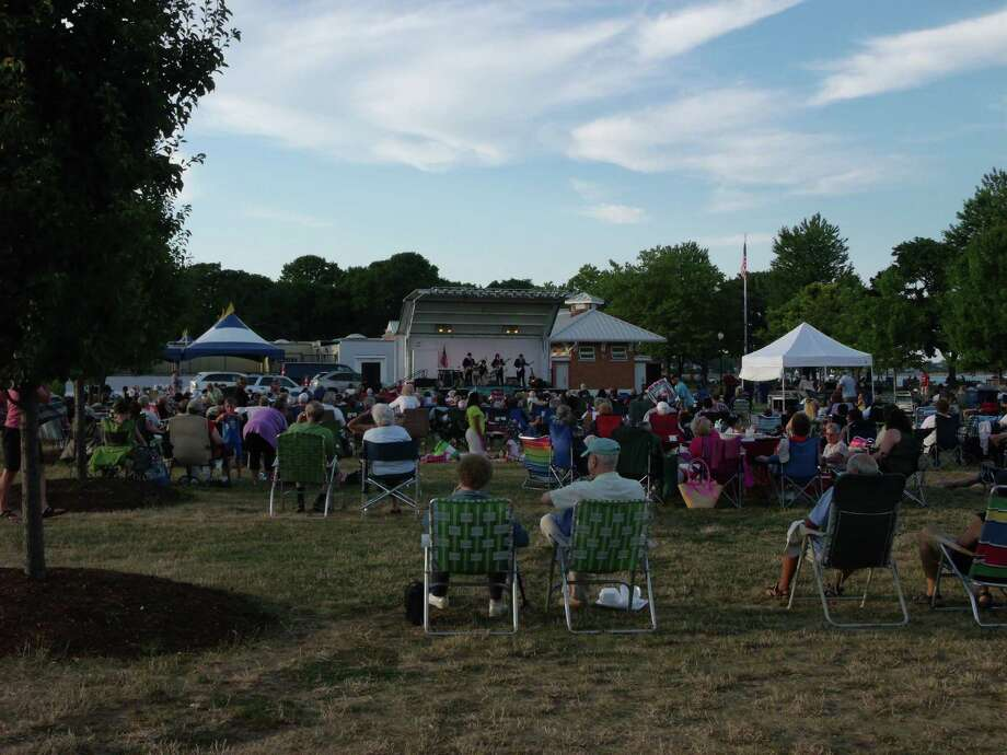 """Concert-goers enjoy the sounds of the Beatles with tribute band """"Ticket To Ride"""" at the City of Norwalk Recreation and Parks Summer Concert Series Sponsored by First County Bank brings music to Calf Pasture Beach. Photo: Todd Tracy / Stamford Advocate"""