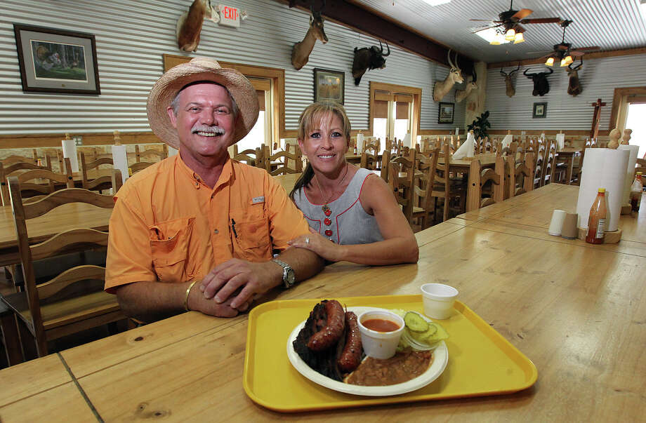 "Harold ""Buzzie"" Hughes (left) and his wife Brenda opened Buzzie's BBQ in 1993. Since that time, Buzzie's went from Comfort, Texas where they started and moved to Kerrville. Buzzie's has been mentioned in Texas Monthly as one of the 50 best in the state. The Hughes pride themselves on providing quality and plentiful barbecue at an affordable price. Photo: Kin Man Hui, SAN ANTONIO EXPRESS-NEWS / ©2012 SAN ANTONIO EXPRESS-NEWS"